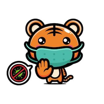 Tigre mignon portant un masque avec une pose d'arrêt de virus