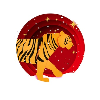 Tigre nouvel an chinois. style de coupe de papier d'animaux sauvages. zodiaque chinois, calendrier. vacances d'hiver. bonne nouvelle carte de voeux 2022. animal sauvage. gros chat. saison de noël.