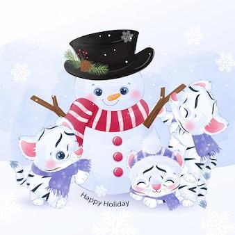 Tigres mignons de bébé et bonhomme de neige jouant ensemble