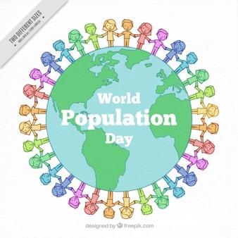 Tiré par la main des gens de couleur autour de l'arrière-plan du monde