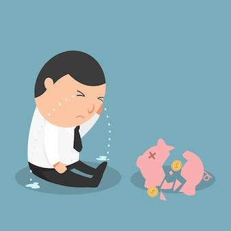 Tirelire cassée - l'homme qui pleure parce qu'il est pauvre