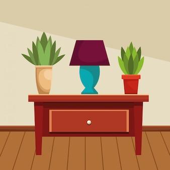Tiroir en bois avec lampe et pots de fleurs