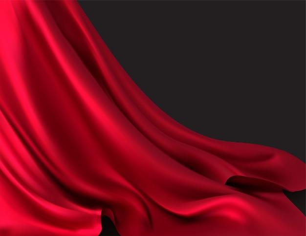 Tissu rouge luxueux dans la pièce noire