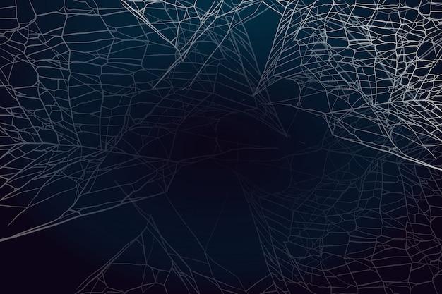 Toile d'araignée sur fond sombre.