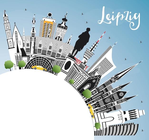 Toits de la ville de leipzig allemagne avec bâtiments gris, ciel bleu et espace de copie. illustration