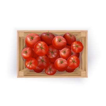 Tomates dans une caisse en bois