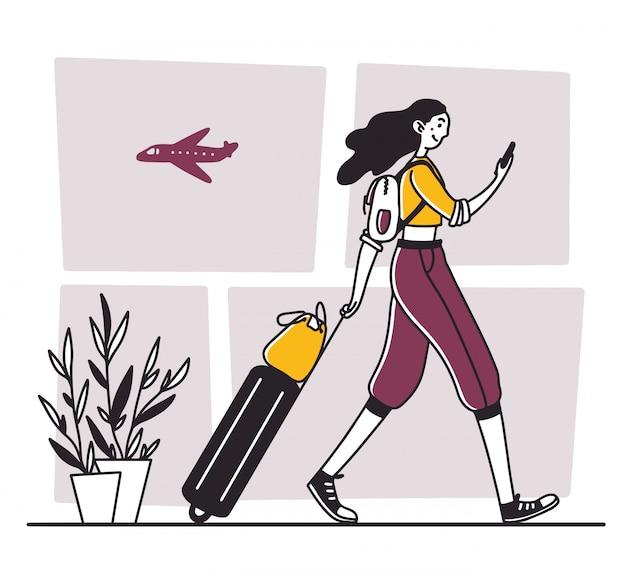 Touriste marchant à l'aéroport
