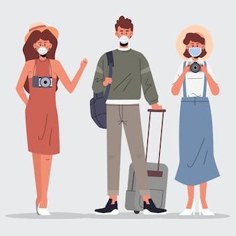 Touristes portant des masques faciaux