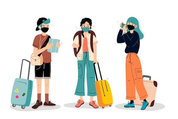 Les touristes portant des masques faciaux