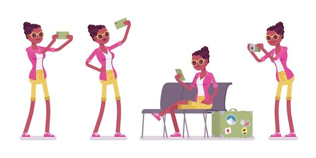 Touristique femelle noire avec des gadgets