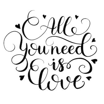 Tout ce dont vous avez besoin, c'est d'amour. phrase de calligraphie dessinée à la main.