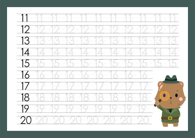 Tracer des numéros en écrivant des feuilles de travail pour l'école maternelle