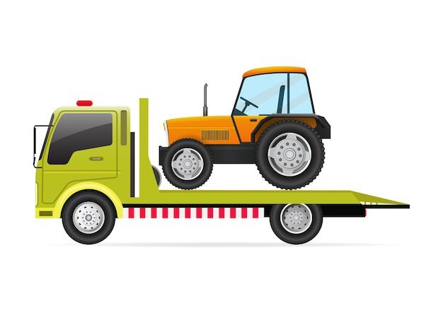 Tracteur sur dépanneuse isolé sur fond blanc.