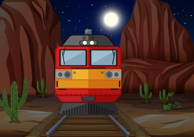 Train sur le chemin de fer pendant la nuit