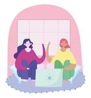 Travail à distance, jeunes femmes assises sur des coussins avec illustration d'ordinateur portable