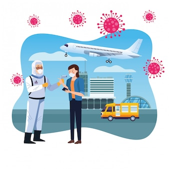 Travailleur de biosécurité vérifiant la température à l'aéroport pour
