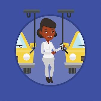 Travailleur contrôlant la chaîne de montage automatisée pour la voiture
