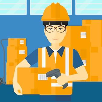 Travailleur vérifiant le code à barres sur la boîte