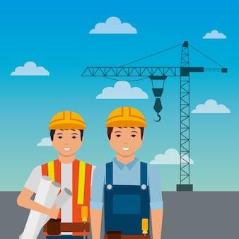Travailleurs de la construction avec grue casque sur fond de ciel