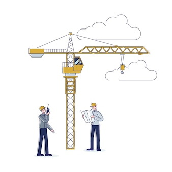 Travailleurs de la construction travaillant ensemble ingénieur et entrepreneur