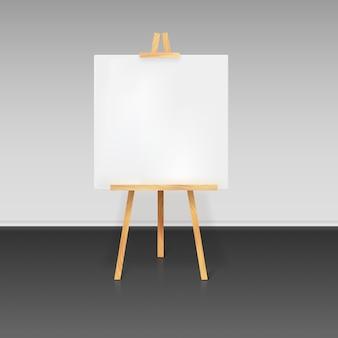 Trépied en bois avec une feuille de papier blanche