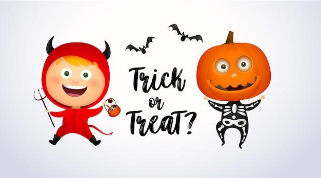 Trick or treat lettrage avec des enfants en costumes du diable et de la citrouille
