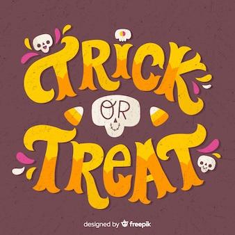 Trick or treat lettrage avec de petits crânes
