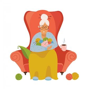 Tricot. vieille femme assise dans un fauteuil confortable à tricoter. illustration plate isolée d'un tricot de grand-mère. la grand-mère aux cheveux gris tient dans ses mains des clefs et un chat.