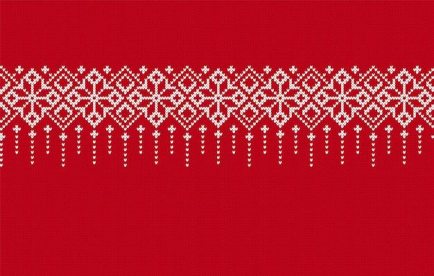 Tricoter une bordure sans couture. texture tricotée rouge. motif de noël. fond traditionnel de la foire de l'île de vacances. impression de noël