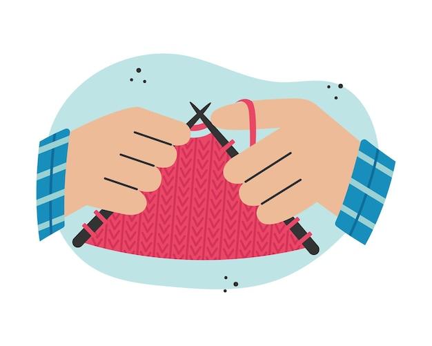 Tricoter des vêtements sur des aiguilles à tricoter. activité créative.