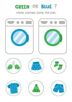 Trier les vêtements par couleurs. vert ou bleu.