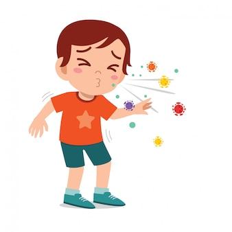 Triste mignon petit garçon enfant éternue à cause de la grippe
