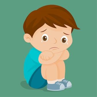 Triste petit garçon en pleurs