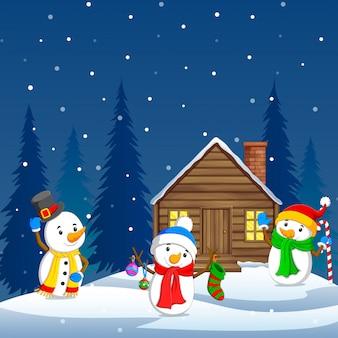 Trois bonhomme de neige et fond d'hiver