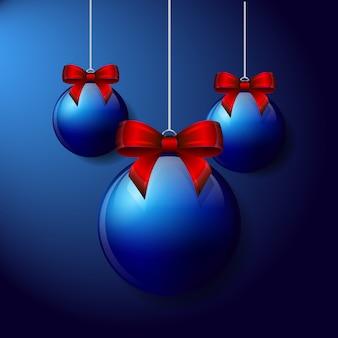 Trois boules de noël avec des arcs sur fond bleu