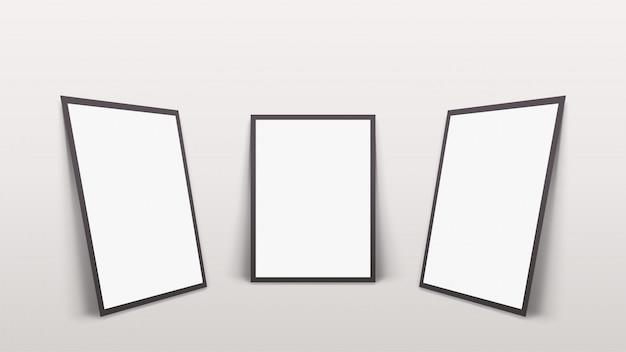 Trois cadres avec des ombres au mur