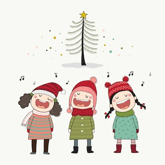 Trois enfants chantant des chants de noël avec pin