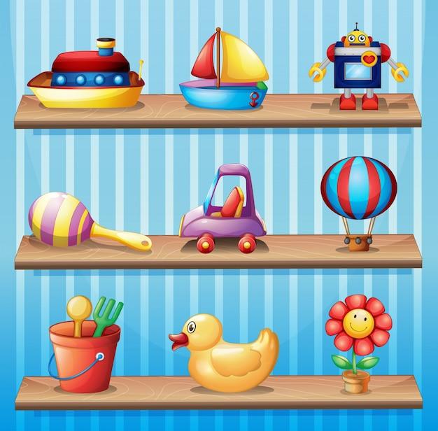 Trois étagères en bois avec différents jouets
