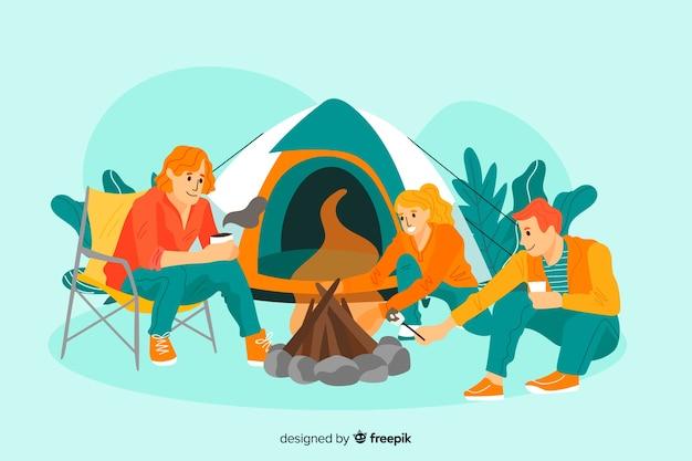 Trois jeunes campant ensemble