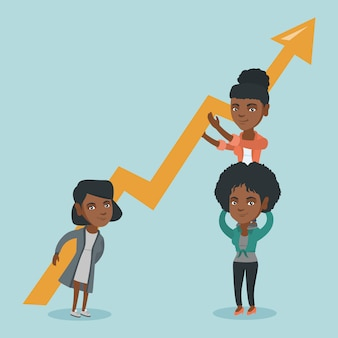 Trois jeunes femmes d'affaires détenant un graphique de croissance.