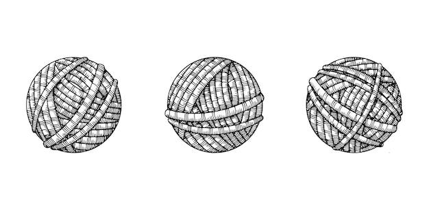 Trois pelotes de laine à tricoter.