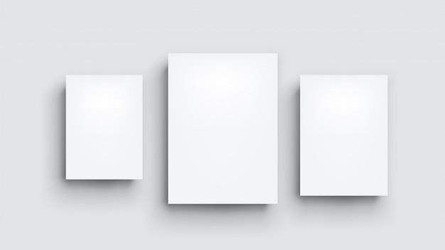 Trois tableaux blancs sur gris