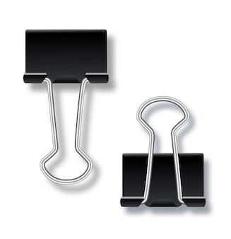 Trombone en métal ou outil fixe de bureau de reliure sur fond isolédeux trombones ouverts et cl...