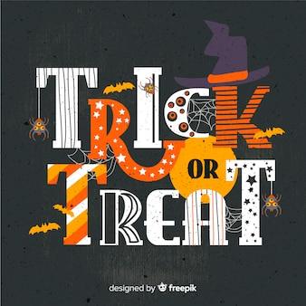 Tromper ou traiter le fond de lettrage d'halloween