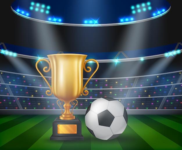 Trophée et ballon de football avec un stade de football