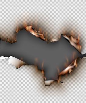 Trou déchiré dans du papier déchiré avec brûlé et flamme sur fond transparent