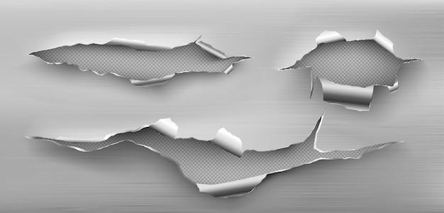 Trous de déchirure en métal avec des bords bouclés, des fissures déchiquetées