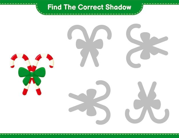 Trouvez la bonne ombre. trouvez et faites correspondre l'ombre correcte de candy canes avec ruban. jeu éducatif pour enfants