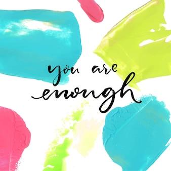 Tu es assez. dire positif sur fond de peinture à l'huile colorée. citation de vecteur inspirant