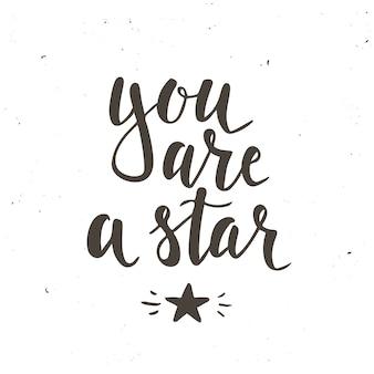 Tu es une étoile. affiche de typographie dessinée à la main. conception calligraphique de t-shirt à la main. typographie vectorielle inspirante